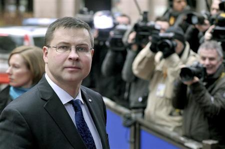 Latvia's Prime Minister Valdis Dombrovskis returns after a short break at the EU council headquarters for an European Union leaders summit meeting to discuss the European Union's long-term budget in Brussels February 8, 2013. REUTERS/Eric Vidal