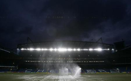 Sprinklers water the pitch at Chelsea's Stamford Bridge stadium in London, February 21, 2006, ahead of the UEFA Champions League soccer match between Chelsea and Barcelona on Wednesday. REUTERS/Mike Finn-Kelcey