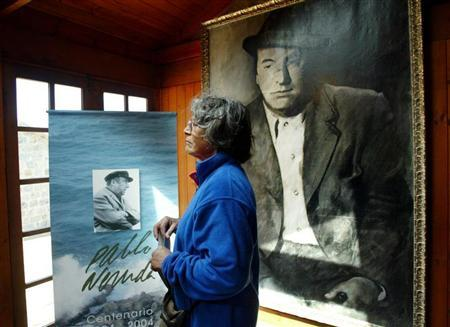 A woman looks at a painting of Chilean poet and Nobel laureate Pablo Neruda during a ceremony the 30th anniversary of his death, in Isla Negra, west of Santiago, September 23, 2003. REUTERS/Carlos Barria