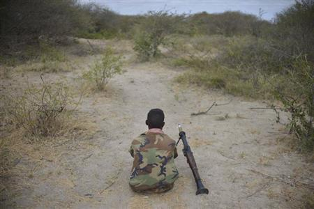 A Somali National Army soldier rests on the frontline with his rocket-propelled grenade (RPG) launcher beside him, while marching towards the town of Buurhakaba on February 24, 2013 in this picture provided by the African Union-United Nations Information Support Team (AU-UN IST). REUTERS/Tobin Jones/AU-UN IST PHOTO/Handout
