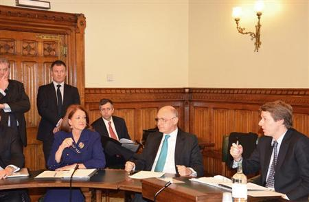 Member of the British Parliament Robin Walker (R) speaks during a meeting with Argentinian Foreign Minister Hector Timerman (C) and Argentine Ambassador to the United Kingdom Alicia Castro during a meeting at the Houses of Parliament in London February 5, 2013. REUTERS/Argentine Foreign Ministry/Handout