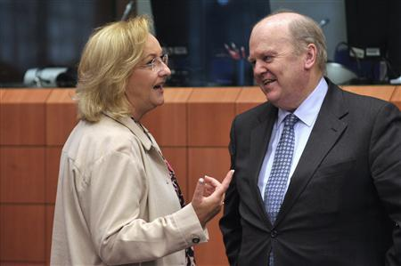 Austria's Finance Minister Maria Fekter (L) and Ireland's Finance Minister Michael Noonan attend a euro zone finance ministers meeting at the European Union Council in Brussels March 4, 2013. REUTERS/Eric Vidal