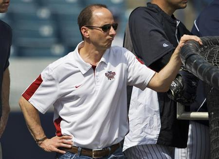 New York Yankees' General Manager Brian Cashman watches batting practice during workouts at the team's spring training complex in Tampa, Florida February 27, 2012. REUTERS/Steve Nesius