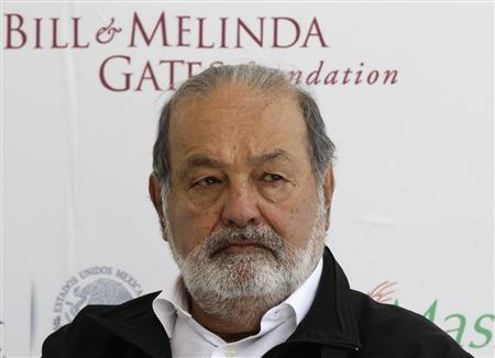 Mexican businessman Carlos Slim listens during a news conference after the inauguration of a new research facility at the International Maize and Wheat Improvement Center, or CIMMYT, in Texcoco outside Mexico City in this file photo from February 13, 2013. REUTERS/Henry Romero/Files