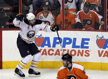 Buffalo Sabres winger Patrick Kaleta (top) celebrates his game winning goal against the Philadelphia Flyers during the third period of Game 1 of their NHL Eastern Conference quarter-final hockey game in Philadelphia, Pennsylvania, in this file photo taken April 14, 2011. REUTERS/Tim Shaffer