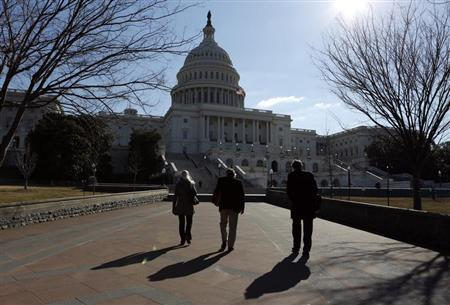 People walk toward the U.S. Capitol in Washington March 4, 2013. REUTERS/Kevin Lamarque