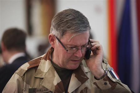 France's Chief of the Defence Staff Admiral Edouard Guillaud speaks on a mobile phone at the presidential palace in Bamako, Mali February 2, 2013.REUTERS/Joe Penney