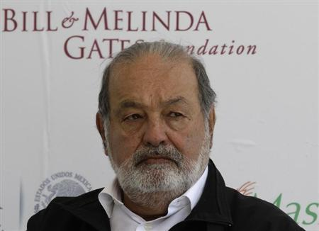Mexican businessman Carlos Slim listens during a news conference after the inauguration of a new research facility at the International Maize and Wheat Improvement Center, or CIMMYT, in Texcoco outside Mexico City February 13, 2013. REUTERS/Henry Romero