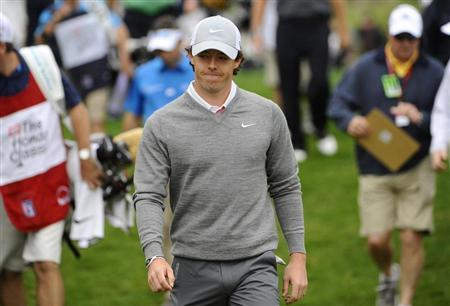 Rory McIlroy of Northern Ireland walks away from the 2nd hole during the first round of play in the Honda Classic PGA golf tournament in Palm Beach Gardens, Florida February 28, 2013. REUTERS/Brian Blanco