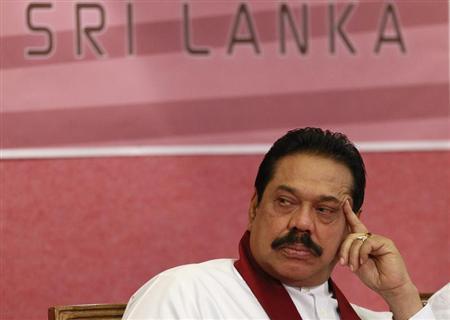 Sri Lanka's President Mahinda Rajapaksa attends the presentation of the 2011 Central Bank of Sri Lanka annual report, in Colombo April 9, 2012. REUTERS/Dinuka Liyanawatte