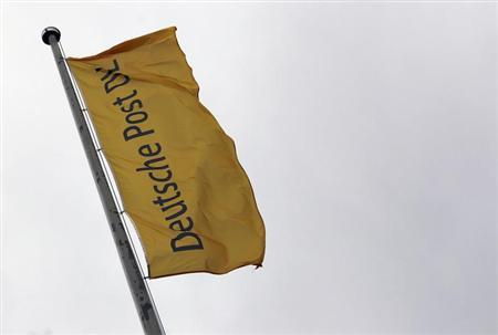 A flag of German postal and logistics group Deutsche Post DHL flutters in the wind ahead of the company's annual shareholder meeting in Frankfurt May 9, 2012. REUTERS/Alex Domanski