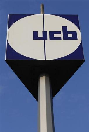 The logo of Belgian drugmaker UCB is seen at the entrance of the company's headquarters in Brussels March 2, 2011. REUTERS/Yves Herman