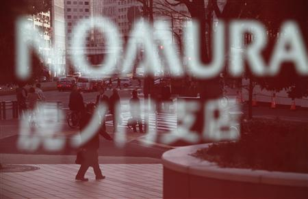 Pedestrians are reflected on a window outside a Nomura Securities branch in Tokyo March 5, 2013. REUTERS/Yuya Shino