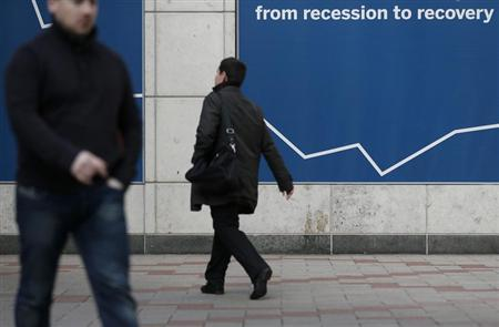 Pedestrians walk through the Canary Wharf business district in east London February 28, 2013. REUTERS/Suzanne Plunkett