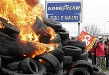 Goodyear workers burn tyres symbolizing 1,173 employees next to the Goodyear tyres factory in Amiens, February 26, 2013. REUTERS/Pascal Rossignol