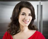 "British television chef Nigella Lawson, author of new cookbook called ""Nigellissima,"" is shown in a handout photo taken in London, courtesy of Hugo Burnand. REUTERS/Hugo Burnand/Handout"