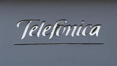 A logo of Spain's telecommunications giant Telefonica is seen on a building in Madrid December 3, 2012. REUTERS/Andrea Comas