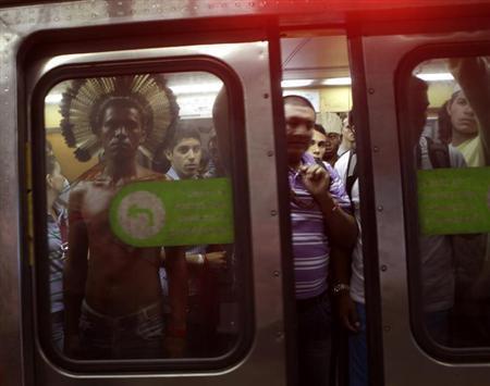 An indigenous man stands in a subway train in Rio de Janeiro June 20, 2012. REUTERS/Ricardo Moraes/Files
