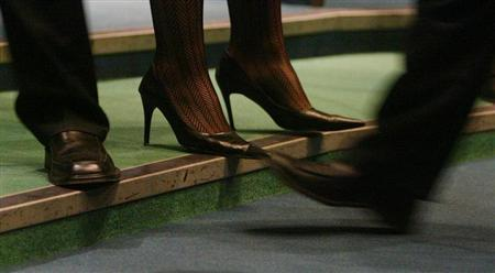The feet of brokers are seen during metal price trading on the floor of the London Metal Exchange in London January 7, 2004. REUTERS/Russell Boyce