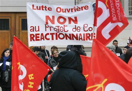 French labour union employees demonstrate in Lyon against the government's economic policy and industrial layoffs, March 5, 2013. Banner reads, ''Lutte Ouvriere (workers' fight) No to the reactionary draft law''. REUTERS/Robert Pratta (FRANCE - Tags: POLITICS BUSINESS EMPLOYMENT) - RTR3ELG2