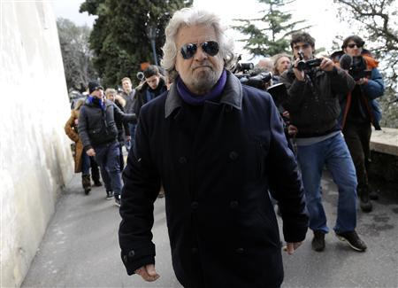 Five Star Movement leader and comedian Beppe Grillo leaves after casting his vote at the polling station in Genoa February 23, 2013. REUTERS/Giorgio Perottino