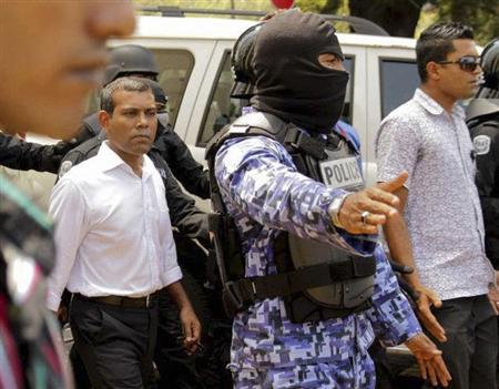 Former Maldives President Mohamed Nasheed (L) is escorted by police officers after being arrested in Male, March 5, 2013. Police in the tropical Indian Ocean resort archipelago of the Maldives arrested Nasheed on Tuesday, 10 days after he left the Indian High Commission where he had taken refuge to avoid detention.REUTERS/Abdullah Jawid