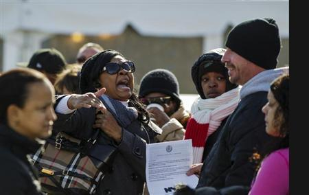 A woman argues with a man while waiting to register for FEMA aid for residents affected by hurricane Sandy in the Queens borough region of the Rockaways in New York November 6, 2012. REUTERS/Lucas Jackson