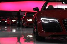 A staff cleans cars on the Audi stand ahead of the 83rd Geneva Car Show at the Palexpo Arena in Geneva March 4, 2013. The Geneva Motor Show will take place from March 7 to 17, 2013. REUTERS/Denis Balibouse