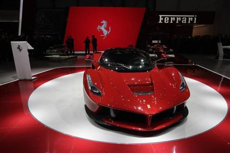 The new LaFerrari hybrid car is pictured on the Ferrari stand during the first media day of the 83rd Geneva Car Show at the Palexpo Arena in Geneva March 5, 2013. REUTERS/Denis Balibouse