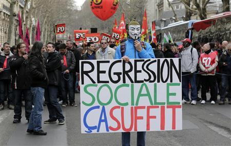 French labour union employees demonstrate in Paris against the government's economic policy and industrial layoffs, March 5, 2013. Sign reads, ''Social Regression -That's Enough''. REUTERS/Jacky Naegelen