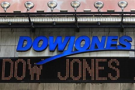 The Dow Jones financial electronic ticker is seen at Times Square in New York July 17, 2012. REUTERS/Shannon Stapleton