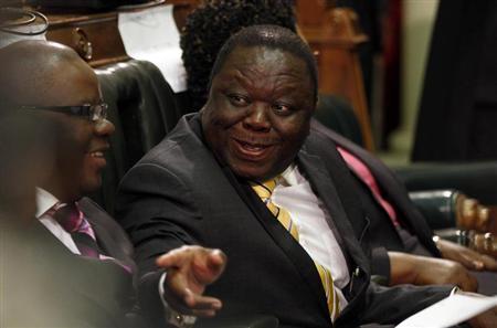 Zimbabwe's Prime Minister Morgan Tsvangirai (R) speaks to Finance Minister Tendai Biti before President Robert Mugabe opened the country's Parliament in Harare, October 30, 2012. REUTERS/Philimon Bulawayo