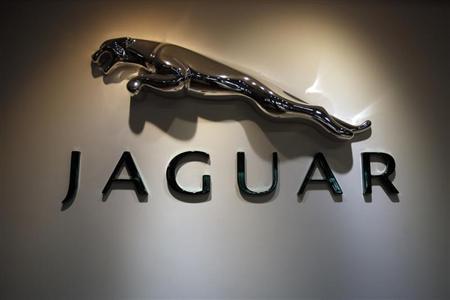 The Jaguar logo is pictured at a Jaguar Land Rover showroom in Mumbai February 13, 2013. REUTERS/Vivek Prakash