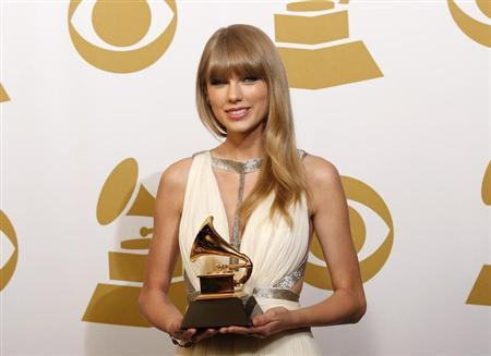 Taylor Swift holds the award for Best Song Written For Visual Media for ''Safe & Sound'' backstage at the 55th annual Grammy Awards in Los Angeles, California February 10, 2013. REUTERS/Mario Anzuoni
