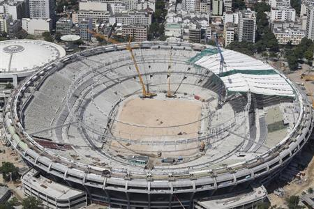 An aerial view shows the roof installation at the Maracana Stadium, which is undergoing renovation for the 2014 World Cup, in Rio de Janeiro February 22, 2013. REUTERS/Ricardo Moraes