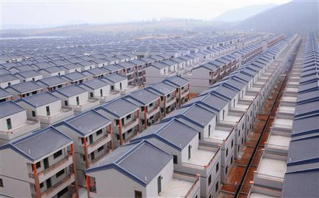 A general view shows newly built houses at Dadun village of Lingshui ethnic Li Autonomous County, Hainan province, in this January 18, 2013 file photo. REUTERS/Stringer/Files