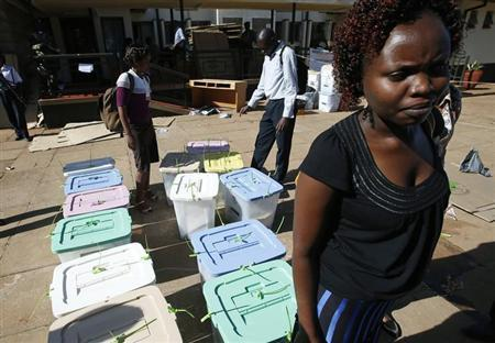 An electoral official stands in front of boxes filled with ballot papers at a tallying center on the outskirts of Nairobi March 5, 2013.REUTERS/Goran Tomasevic