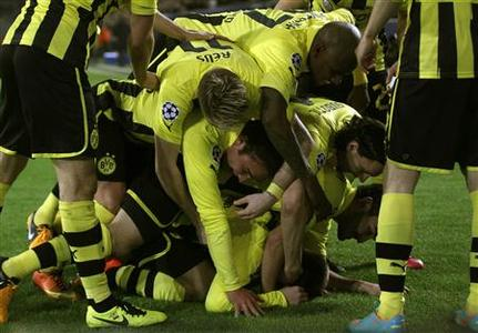 Borussia Dortmund's players celebrate a goal against Shakhtar Donetsk during the Champions League soccer match in Dortmund March 5, 2013. REUTERS/Ina Fassbender
