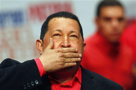 Venezuela's President Hugo Chavez blows a kiss as he arrives at a rally with supporters in Caracas in this February 23, 2012 file photo. REUTERS/Jorge Silva/Files