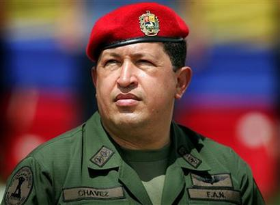 Venezuela's President Hugo Chavez wears an army uniform and the red beret of his parachute regiment while attending a military parade in Caracas in this April 13, 2005 file photo. REUTERS/Jorge Silva/Files