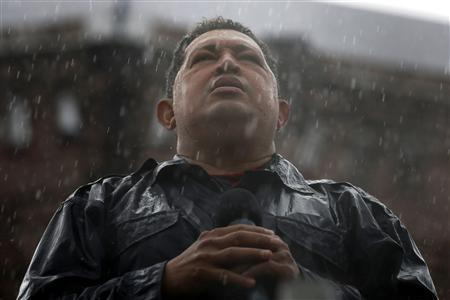 Venezuela's President and presidential candidate Hugo Chavez speaks in the rain during his closing campaign rally in Caracas in this October 4, 2012 file photo. REUTERS/Jorge Silva/Files