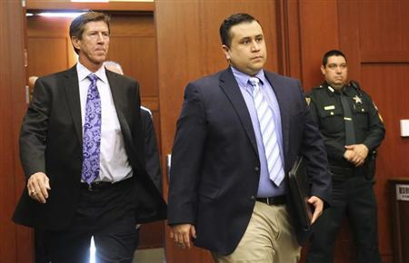 George Zimmerman arrives with his lead counsel, Mark O'Mara (L) for a hearing in Seminole circuit court in Sanford, Florida February 5, 2013. REUTERS/Joe Burbank/Pool