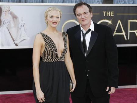 Quentin Tarantino, best original screenplay nominee for his film ''Django Unchained'', poses on the red carpet with his girlfriend Lianne Spiderbaby as they arrive at the 85th Academy Awards in Hollywood, California February 24, 2013. REUTERS/Lucas Jackson