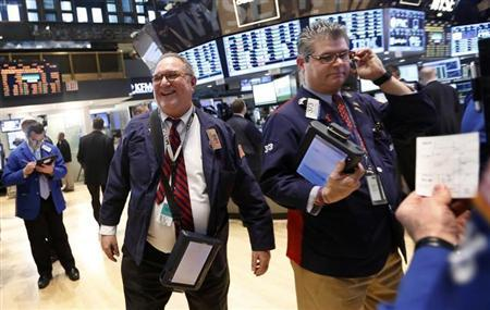 Traders work on the floor at the New York Stock Exchange just following the closing bell, March 5, 2013. REUTERS/Brendan McDermid