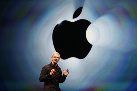 Apple Inc. CEO Tim Cook takes the stage during Apple Inc.'s iPhone media event in San Francisco, California September 12, 2012. REUTERS/Beck Diefenbac/Files