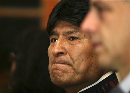 Bolivia's President Evo Morales attends a ceremony in honor of Venezuela's President Hugo Chavez at the Venezuelan embassy in La Paz March 5, 2013. REUTERS/Gaston Brito