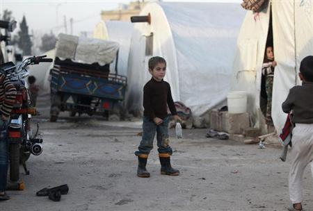 Syrian refugee children stand outside their tents at the Bab Al-Salam refugee camp in Azaz, near the Syrian-Turkish border February 25, 2013. REUTERS/Giath Taha