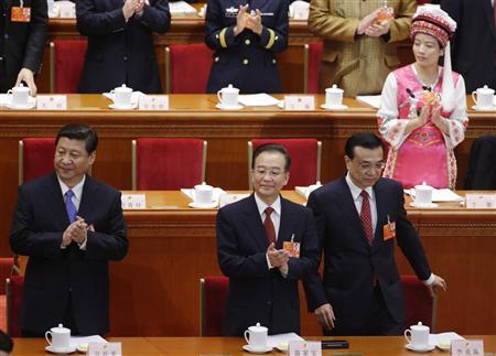 China's Communist Party Chief Xi Jinping (L), China's Premier Wen Jiabao (C) and other delegates clap as China's Vice-Premier Li Keqiang (R) arrives at his seat during the opening ceremony of National People's Congress (NPC) at the Great Hall of the People in Beijing, March 5, 2013. REUTERS/Jason Lee