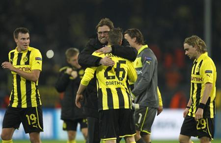 Borussia Dortmund's coach Juergen Klopp hugs his players after the Champions League match against Shakhtar Donetsk in Dortmund March 5, 2013. REUTERS/Ina Fassbender