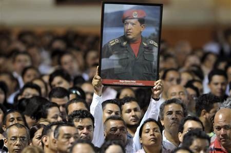 A Nicaraguan supporter of Venezuelan President Hugo Chavez holds a poster of him at the Revolution Square in Managua March 5, 2013. REUTERS/ Stringer